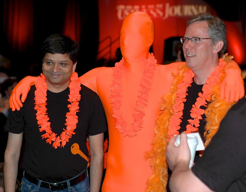 Dharmesh Shah and Brian Halligan With A HubSpot Orangeman