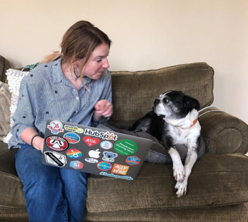 HubSpot employee with dog & laptop.