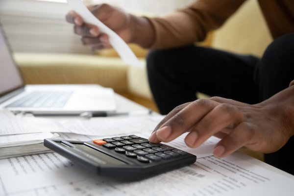manager calculating numbers according to sales audit procedures