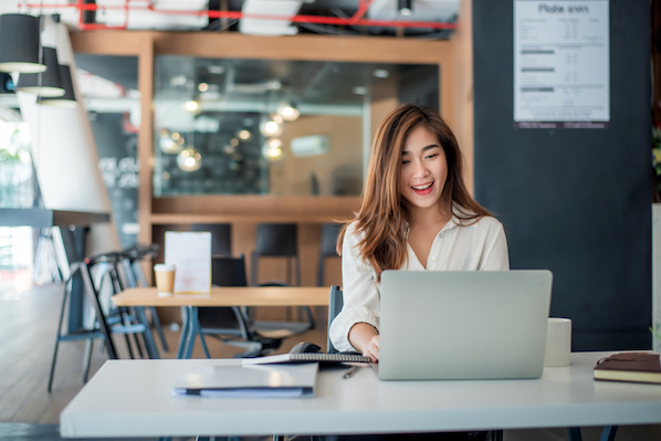 businesswomen using different types of automation for her business